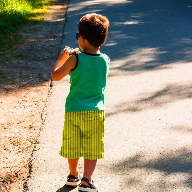 """""""Little boy with photo camera"""" stock image"""