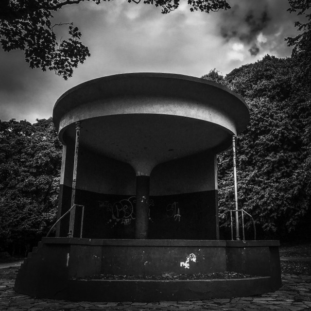 """oppressive looking mono bandstand"" stock image"
