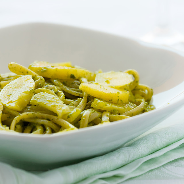 """""""Closeup of linguine pasta with pesto genovese and potatoes"""" stock image"""