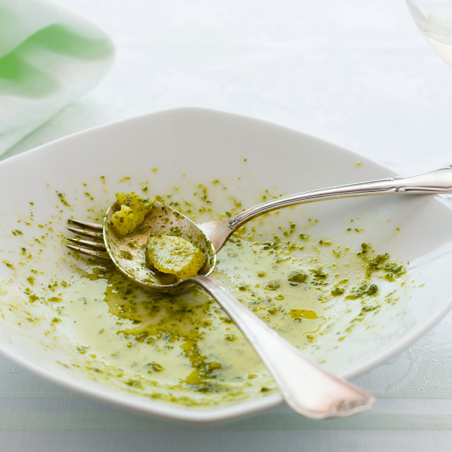 """""""Closeup of eaten linguine pasta plate with pesto genovese and potatoes"""" stock image"""