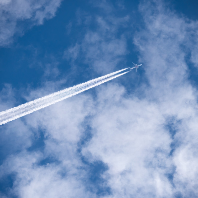 """Plane with contrails"" stock image"