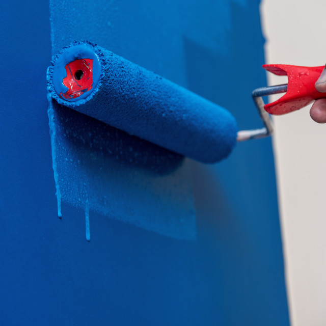 """""""workman painting the wall in blue"""" stock image"""