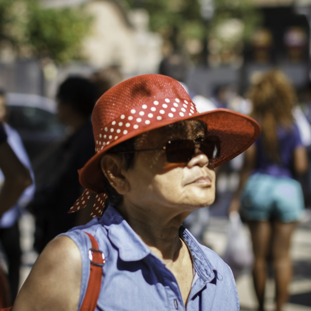 """Asian Woman in Red Hat"" stock image"