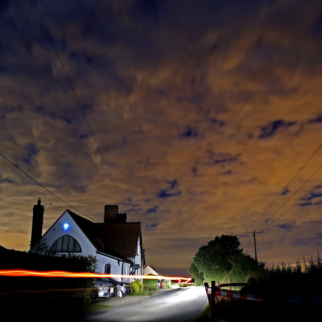 """""""Countryside house and car lights"""" stock image"""