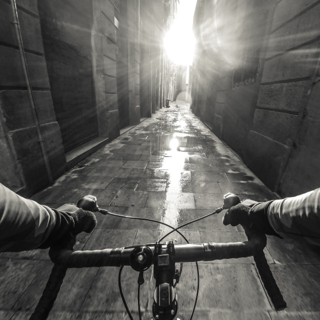"""Solo Cyclist in Laneway in Black and White"" stock image"