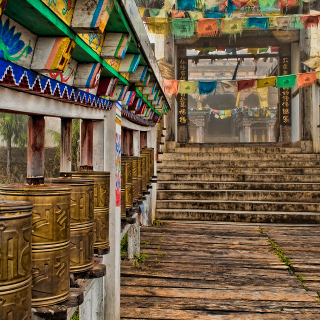 """""""Prayer Wheels in Front of Buddhist Temple"""" stock image"""