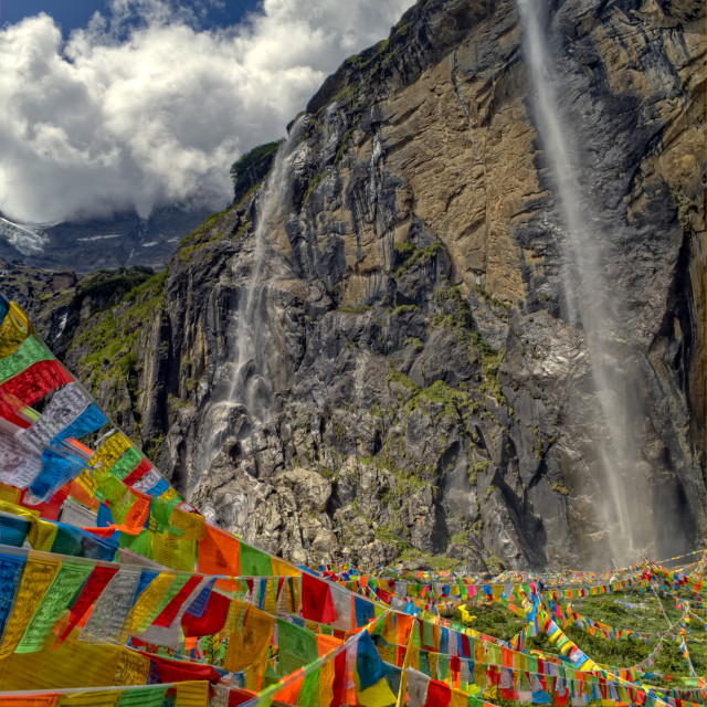 """""""Colorful Prayer Flags in Front of Sacred Buddhist Waterfall"""" stock image"""