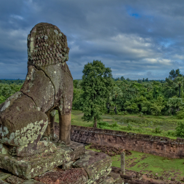 """Stone Lion At Angkor Wat Looking At Jungle"" stock image"