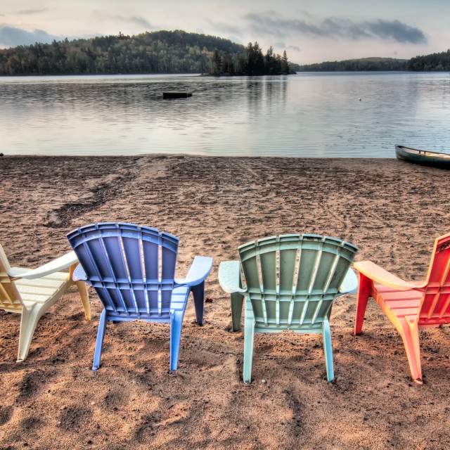 """""""Four Patio Chairs Looking Over Lake"""" stock image"""