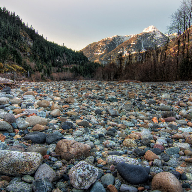 """""""Field of natural stones with mountains"""" stock image"""