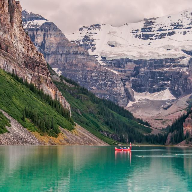 """Lake Louise Canoe With Glacier"" stock image"