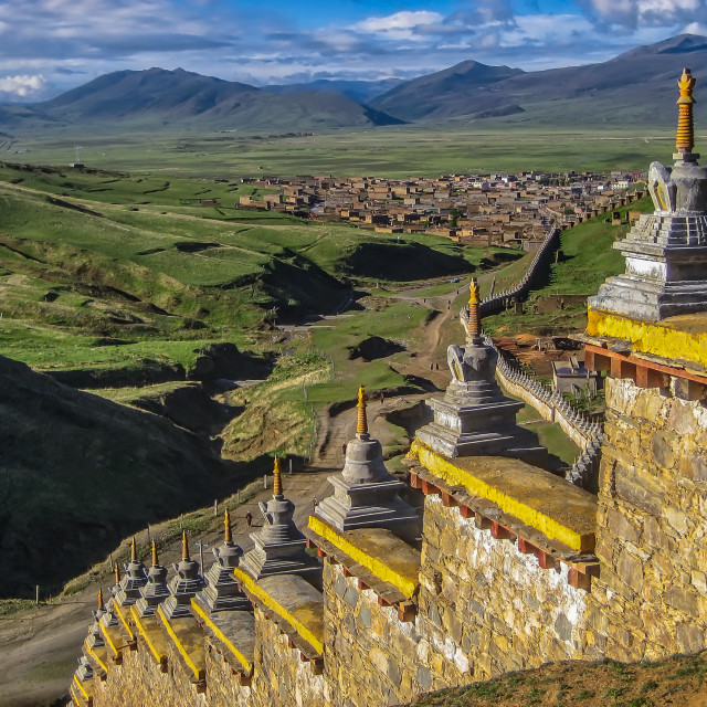 """""""Wall with Stupas and Distant town"""" stock image"""