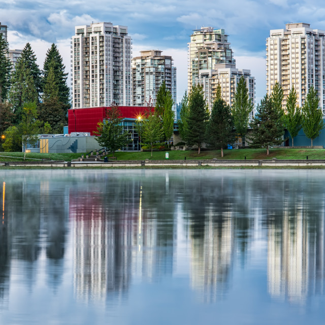 """""""Condo Buildings Reflected in Lake with Trees"""" stock image"""