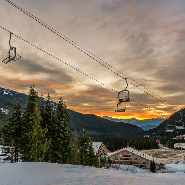 """Empty Ski Lift Chairs At Sunrise"" stock image"
