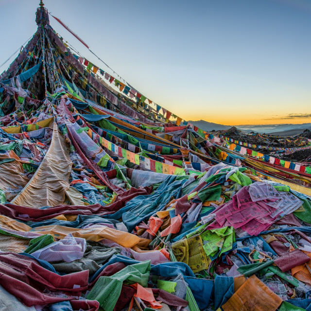 """Piles of Frozen Prayer Flags at Sunrise"" stock image"