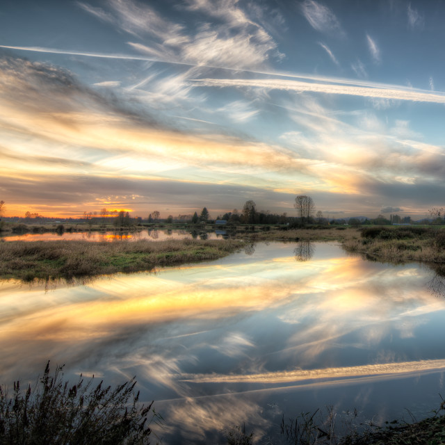 """Dynamic Sky Reflected in river"" stock image"