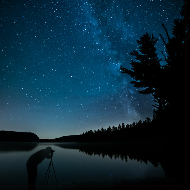 """Photographer Taking Night Photos of Milky Way"" stock image"