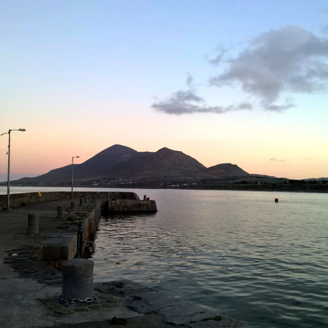 """Croagh Patrick from Old Head harbour, dusk, December"" stock image"