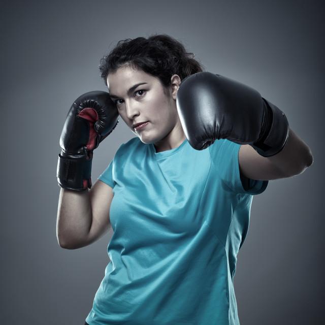"""Latino woman boxer"" stock image"