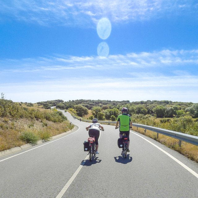 """Two Touring Cyclists Enjoying a Downhill Ride"" stock image"