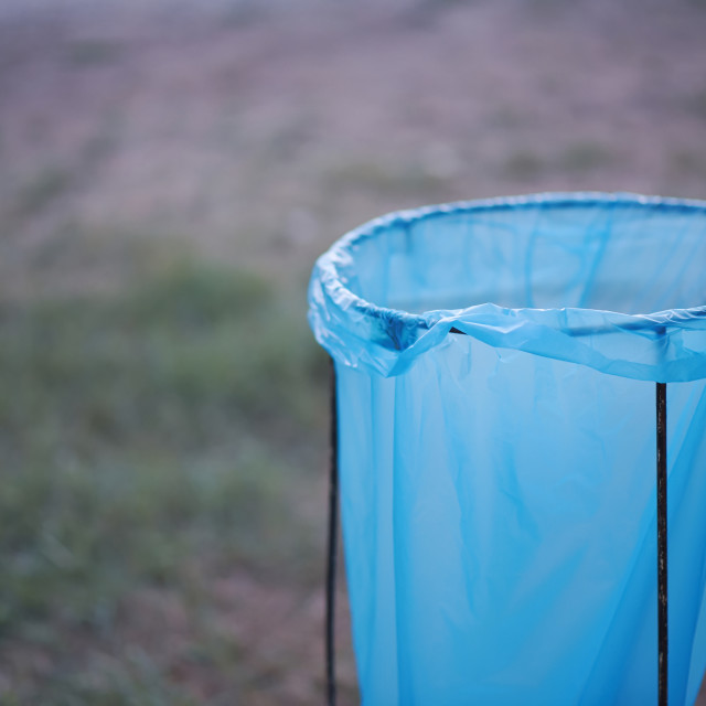 """Blue Plastic Garbage Bag"" stock image"
