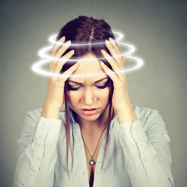 """""""Woman with vertigo. Young female patient suffering from dizziness"""" stock image"""