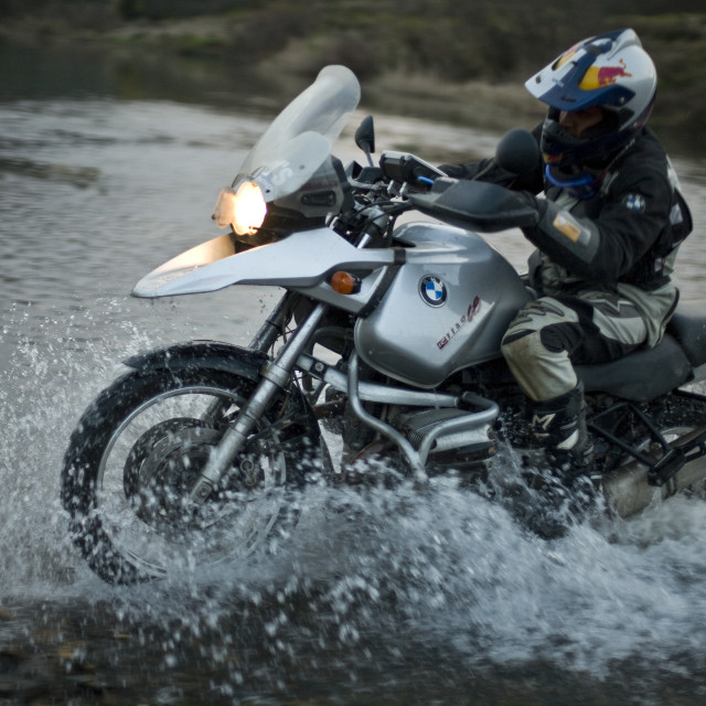 """Crossing the river on a BMW"" stock image"
