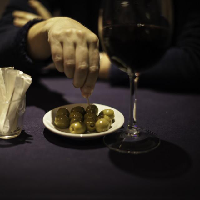"""Eating Olives"" stock image"
