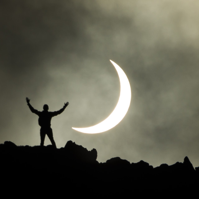 """Edinburgh Solar Eclipse 2015 - Jamie on Salisbury Crags"" stock image"