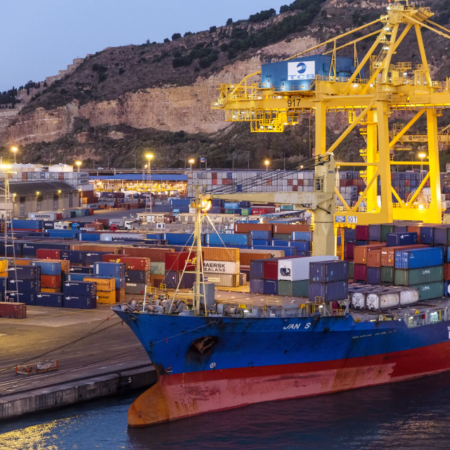 """""""Cargo containers being loaded on to a shipping freighter , Barcelona, Spain"""" stock image"""