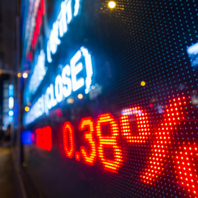 """Stock market display in the street at night"" stock image"
