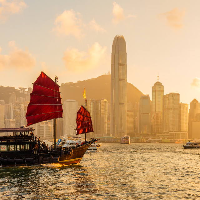 """Chinese wooden red sails ship in Hong Kong Victoria harbor at sunset time"" stock image"