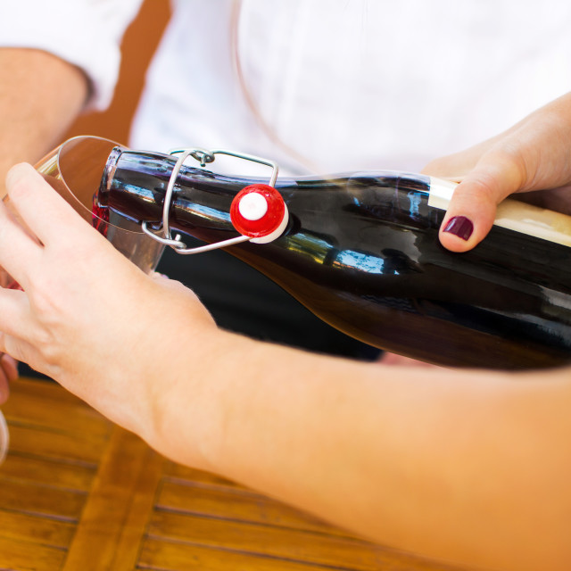 """Girl pouring wine to her boyfriend"" stock image"