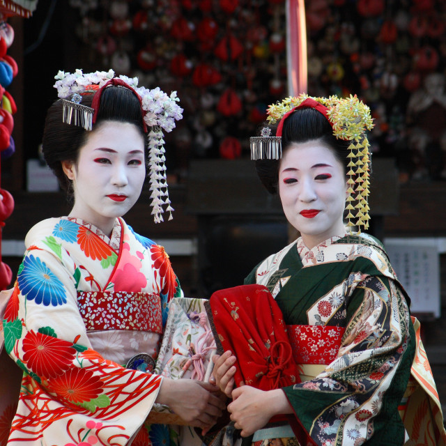 """Two maiko - apprentice geisha - visit a shrine in the historic Gion district..."" stock image"