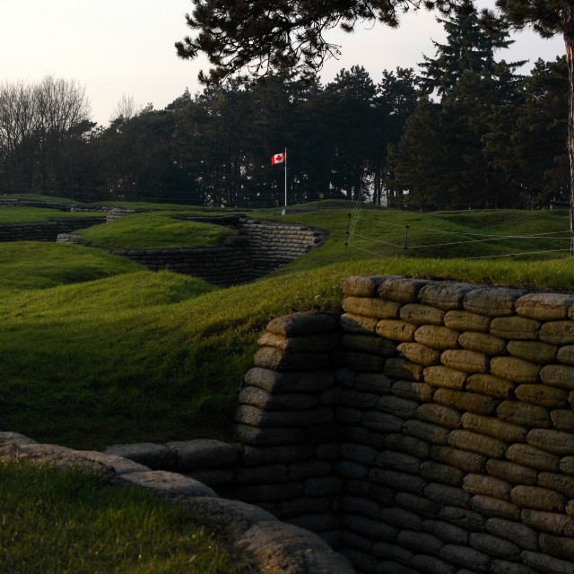 """""""The Canadian flag flies over the trenches at the Vimy Ridge memorial to..."""" stock image"""