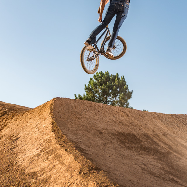 """BMX Bike Stunt look back"" stock image"