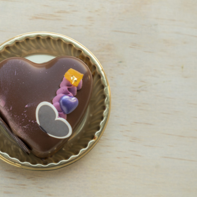 """Fancy Heart shaped chocolate cake on a wooden table"" stock image"