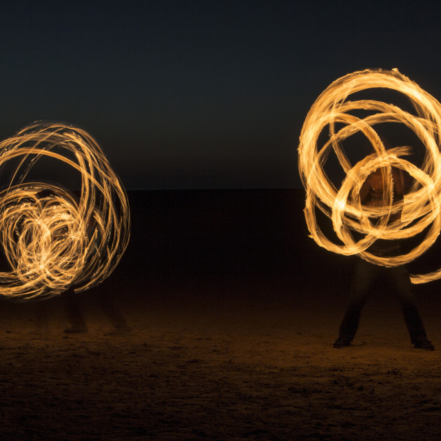 """Fire Spinning Duo"" stock image"