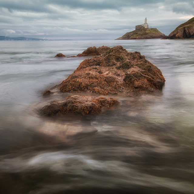 """Outgoing tide at Mumbles lighthouse"" stock image"
