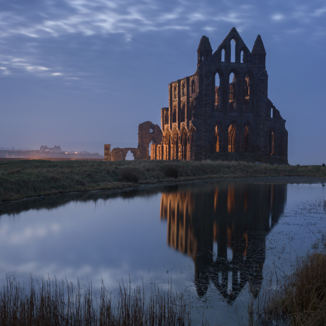 """Whitby Abbey, a prominent landmark perched on the cliffs above Whitby and..."" stock image"