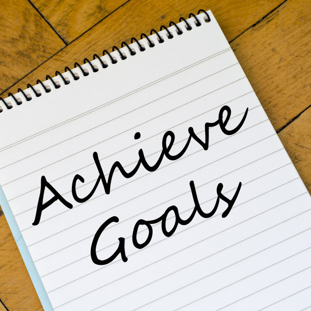 """""""Achieve goals concept on notebook"""" stock image"""