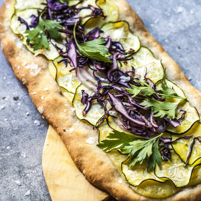 """Zucchini, Red Cabbage, Onion and Cheese Pizza"" stock image"