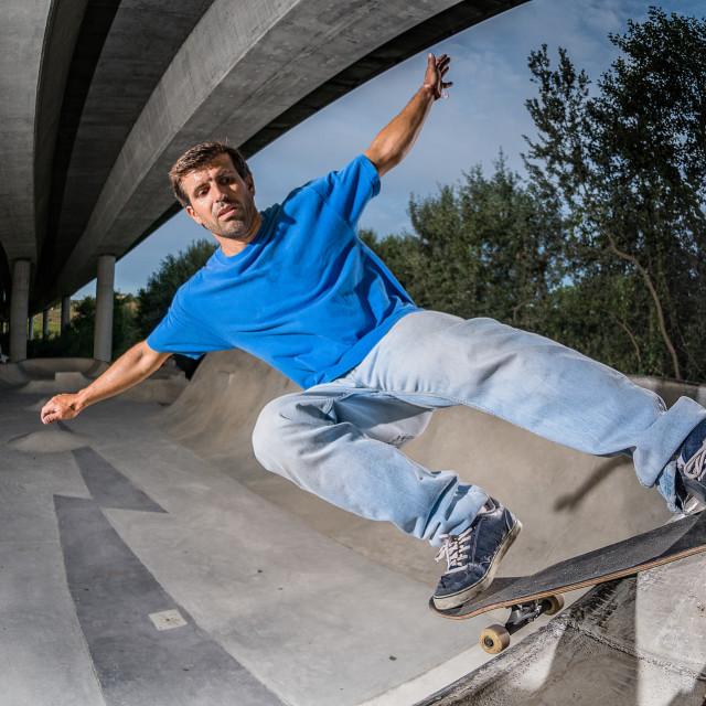 """""""Skateboarder in a concrete skatepark"""" stock image"""