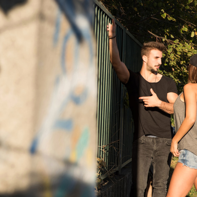 """Young HipHop Couple in a urban environment"" stock image"