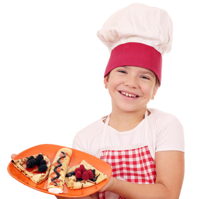 """happy little girl cook with crepes"" stock image"