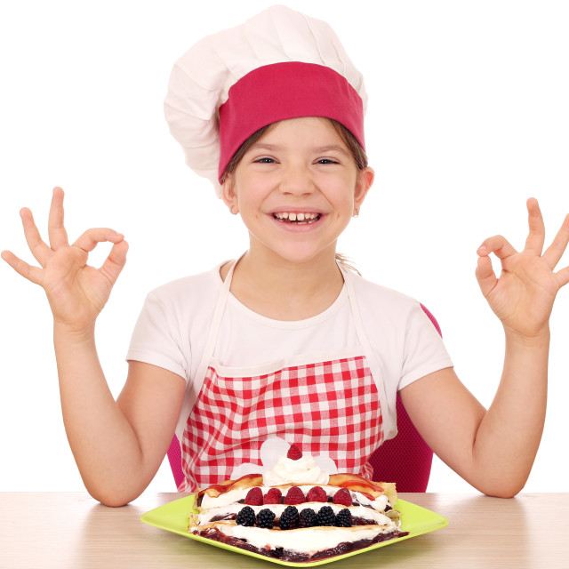 """happy little girl cook with crepes and ok hand signs"" stock image"