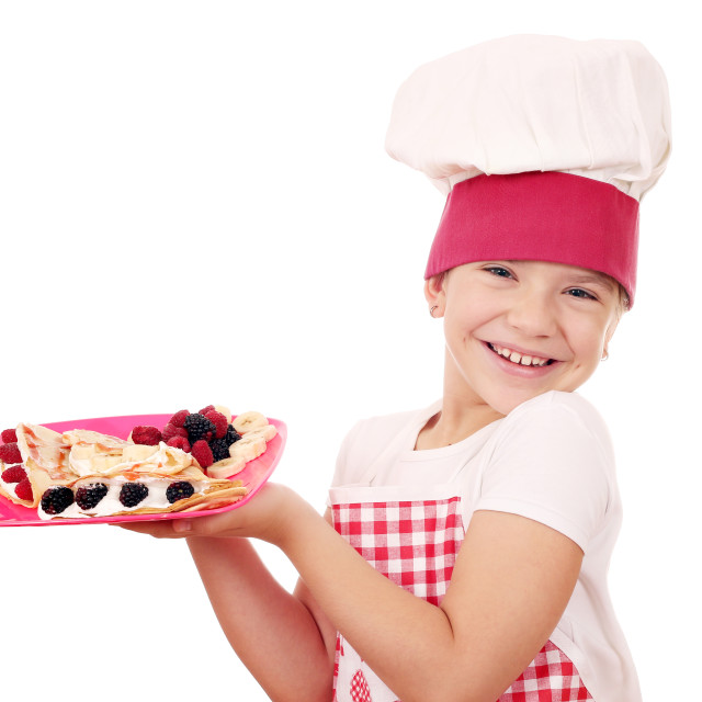 """happy little girl cook with sweet crepes"" stock image"