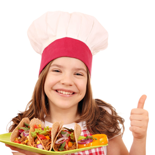 """happy little girl cook with tacos and thumb up"" stock image"
