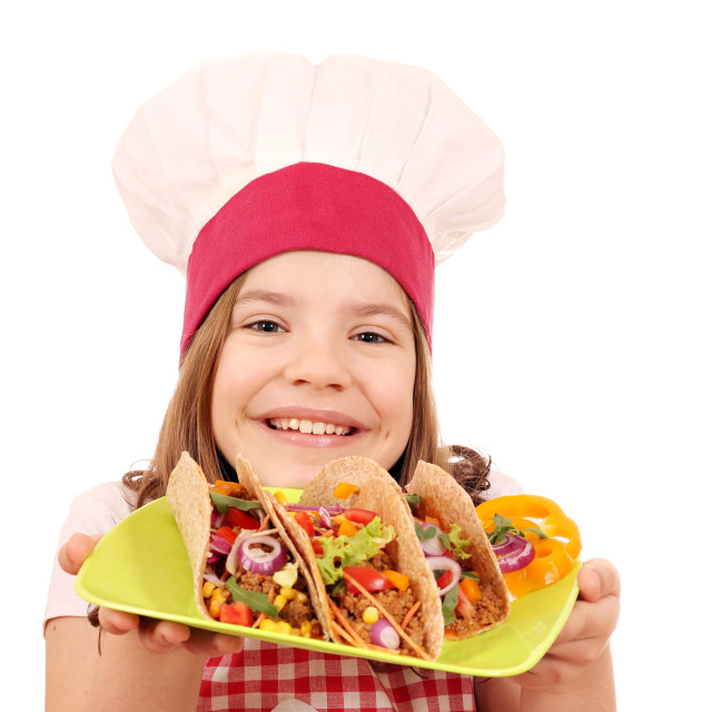 """happy little girl cook with tacos"" stock image"