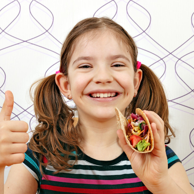 """happy little girl with tacos and thumb up"" stock image"